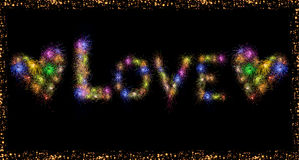 Love word text and Heart shape colorful fireworks. Love text and Heart shape made out of combining colorful firework images Royalty Free Stock Photo