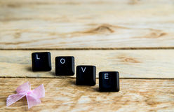 Love word on the wooden floor5 Royalty Free Stock Photos