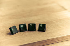 Love word on the wooden floor8 Stock Image
