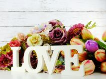 Free Love Word Wooden Letter With Artificial Flowers Decor Stock Photo - 109072290