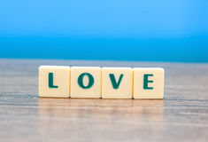 Love word  on wooden table Stock Photos