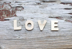 Love. Word on wooden vintage scratched background royalty free stock photo