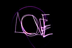 Love. The word love written in light stock photography