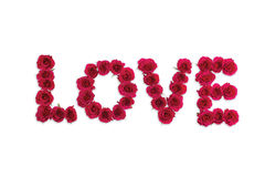Love. Word 'love' written with pink roses Royalty Free Stock Photo