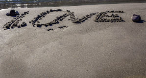 Love word written on sand Royalty Free Stock Images