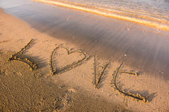 Love word written in sand. Summer beach concept Royalty Free Stock Photo