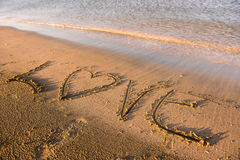 Love word written in sand. Summer beach concept Royalty Free Stock Photos