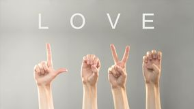 Love word written and shown with hands in deaf asl language, expressing feelings. Stock footage stock video footage