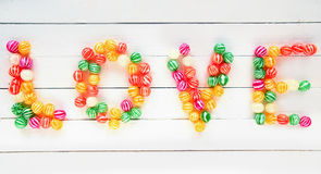 The Love word written with sweet candies Royalty Free Stock Photography