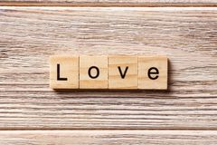 Love word written on wood block. love text on table, concept Stock Image