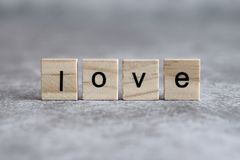 Love word written on wood cube Royalty Free Stock Images