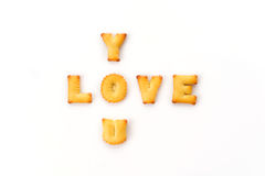 Love wording by a b c biscuit Royalty Free Stock Images