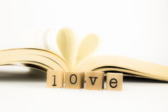 Love wording and a book with heart shape Royalty Free Stock Photography