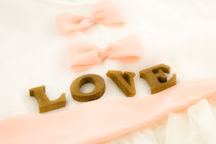 Love wording and dress with peach bow ribbon Royalty Free Stock Photography