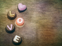 Love wording on wood background Royalty Free Stock Image