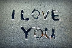 Love. The words 'I love you' on the frozen glass stock photography