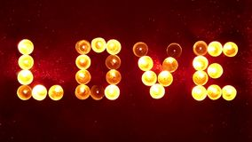 Love words written in candles. Candles and candlelights with star filter stock footage