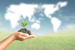 We love the world of ideas, man planted a banana in the hands wo. Rld map background stock photography
