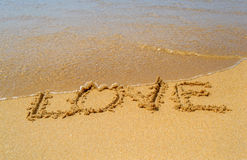 Love write on the sand beach Royalty Free Stock Image