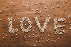 `Love` writing made out of little wooden hearts Royalty Free Stock Images