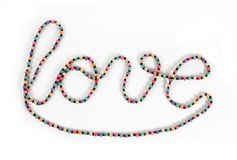 Love writing symbol made by necklace Royalty Free Stock Photos