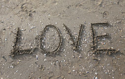 LOVE written on the beach Royalty Free Stock Photos