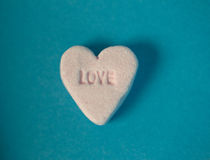 Love written in sweet candy heart shape Stock Photos