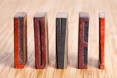 Love written with colored vintage letterpress  Retro vintage letterpress type. Soft focus! Stock Photography