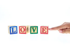 LOVE written in colorful alphabet blocks isolated on white Royalty Free Stock Photos