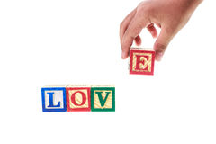 LOVE written in colorful alphabet blocks isolated on white Stock Photos
