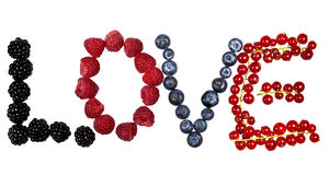 Love written with colorful berries Stock Image