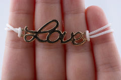 Love written lettersl  in hand Royalty Free Stock Images