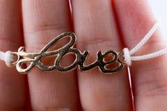 Love written lettersl  in hand Stock Photography