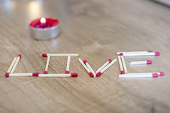 Love written with matches Stock Photos