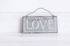 Love written on metal plate Royalty Free Stock Image