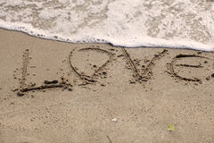 Love written near the sea Royalty Free Stock Image