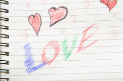 Love Written in Notebook. Pen drawing love doodle in a notebook Stock Photo