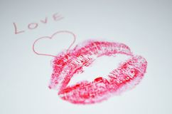 `Love` is written on the paper with lipstick kiss