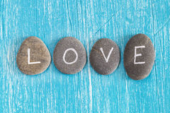 Love written on pebbles Royalty Free Stock Photos