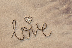 Love written in Sand. Close up of word 'love' written in sand at beach Royalty Free Stock Photos