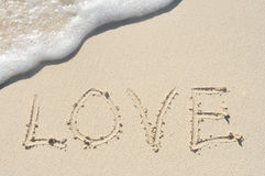 Love Written in Sand on Beach Stock Photos