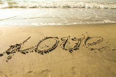 Love written on the sand. With sea royalty free stock photos