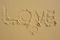Love written in the sand Stock Photography