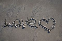 Love Written in Sand Royalty Free Stock Image