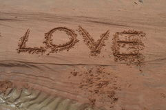 Love written on the sand Royalty Free Stock Photography