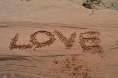 Love written on the sand Stock Photos