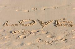 Love written on sunny beach Stock Image