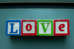 Love. Is written on toy blocks royalty free stock photo