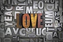 Love. Written in vintage letterpress type royalty free stock photos
