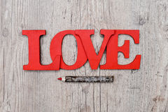 Love written on wood Stock Images